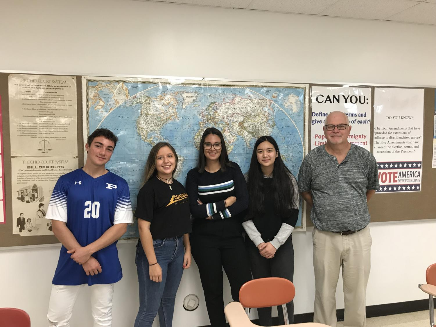 Left to Right: Samuele Franceschetti, Isabel Tabares, Alice Corrias,  Ayazhan Fazylova, and Mr. Rowe at a get together for the foreign exchange students.